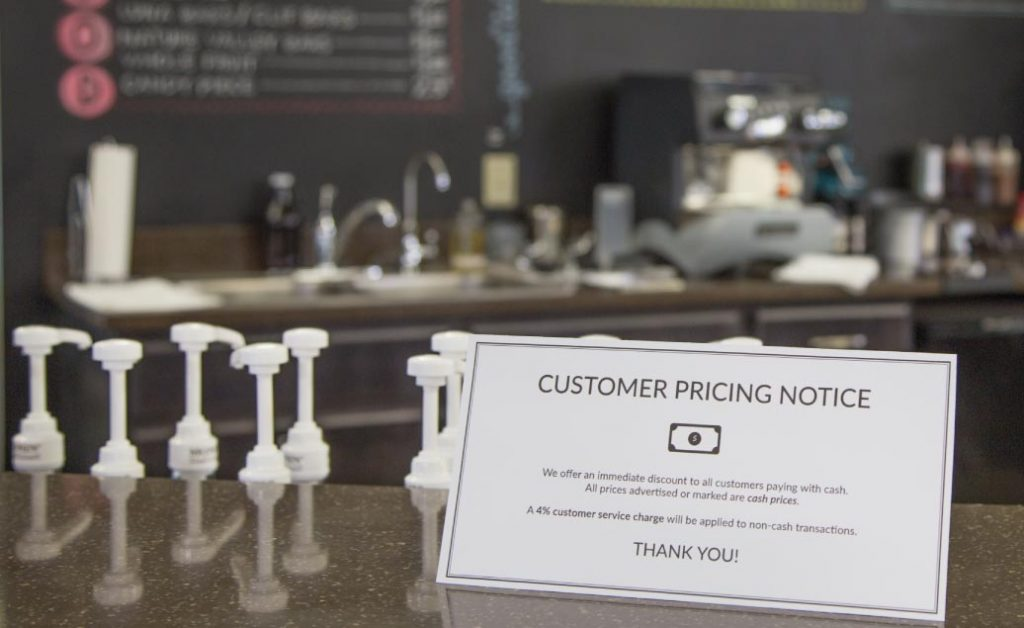 A customer pricing notice must be visible to inform customers of the customer service charge when paying with a credit card