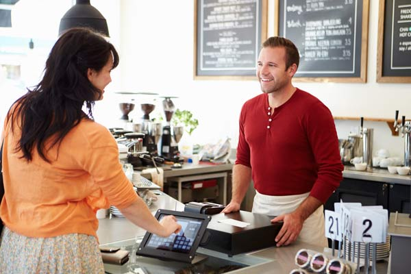 credit card payment being processed in a coffee shop