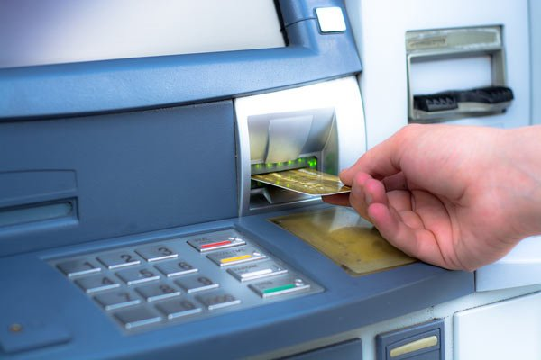 withdrawing cash at an ATM machine